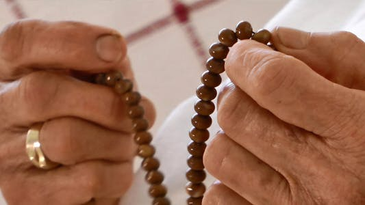 Thumbnail for Old Woman Prays With Rosary 5