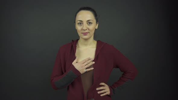 Thumbnail for Actress Plays Role of Confused Lady Holding Hand on Chest