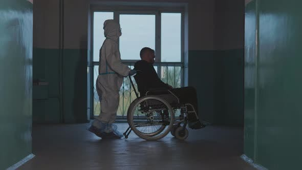 Thumbnail for Doctor pushes the patient in a wheelchair