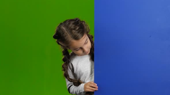 Thumbnail for Kid Looks Out From Behind a Blue Board and Shows a Thumbs Up. Green Screen