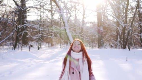 Woman Having Fun in the Winter Park