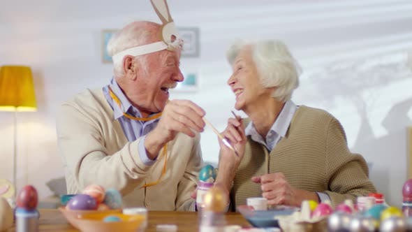 Cover Image for Cheerful Elderly Couple Preparing for Easter