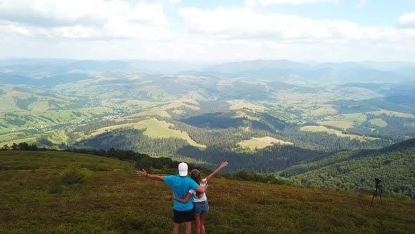 Tourist in love enjoys the mountain views.