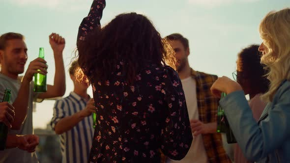 Multiethnic Friends Toasting with Beer at Sunset Party