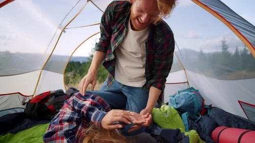 Woman and Man Having Fun Together in Tent