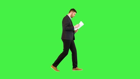 Concentrated Businessman Boss Read Contract Documents Walking Manager Look Through Paper Agreement