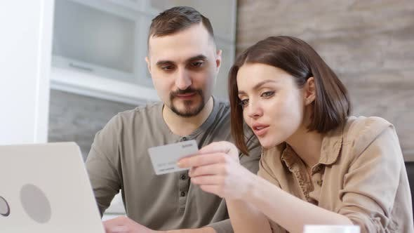 Thumbnail for Happy Couple Buying Item from Online Store at Home