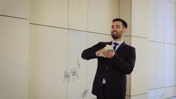 Thumbnail for Young Happy Businessman Dancing and Throwing Money. Slow Motion. Successful Business or Winning the