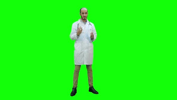 Thumbnail for Doctor Explaining Difference Between Two Bottles of Pills on a Green Screen, Chroma Key