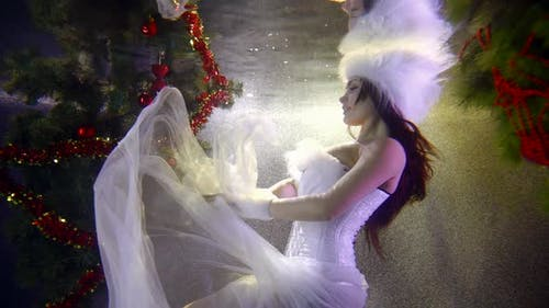 Winter Fairy Woman Is Moving in Water of Swimming Pool, Image of Snow Queen