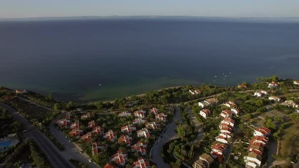 Thumbnail for Flying Over Town on Waterfront and Blue Sea Trikorfo Beach Greece