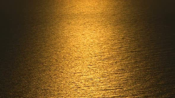 Surface of Endless Rippling Sea in Golden Light of Sunset Glow, Beautiful Nature