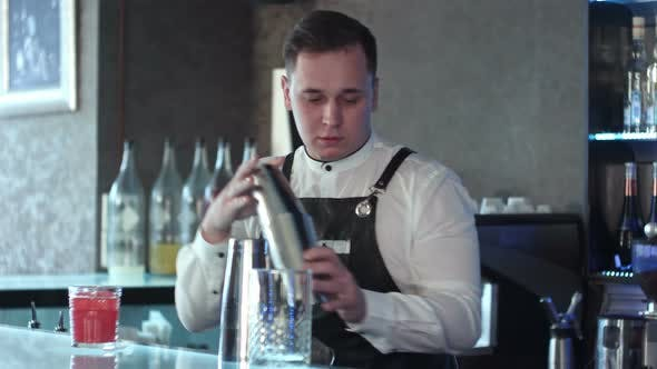 Cover Image for Bartender Making Alcohol Coctail in Restaurant