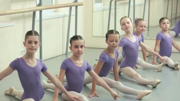 Group of Ballet Girls Doing Split at Dance Studio