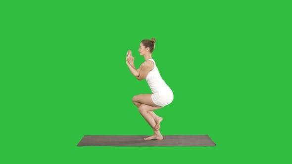 Thumbnail for Beautiful young woman doing yoga exercise for ankles calves