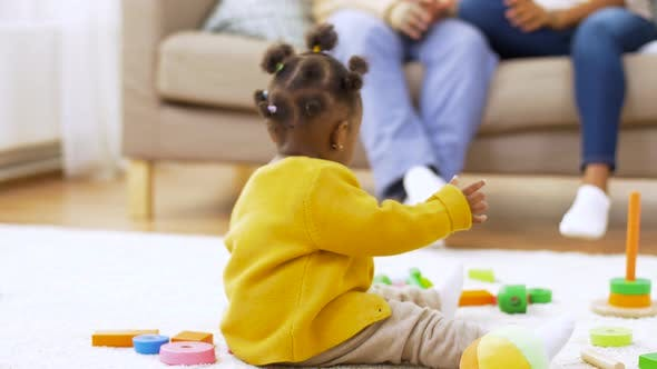 Thumbnail for African Baby Girl Playing with Toy Blocks at Home