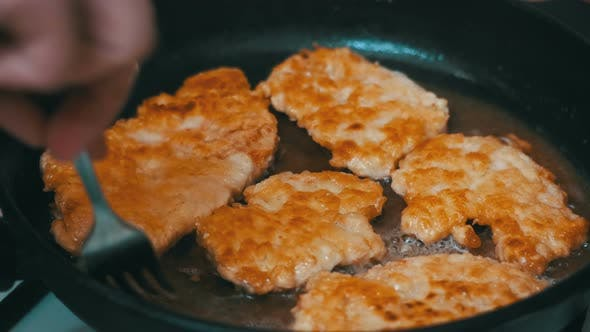 Thumbnail for Frying Meat Chops on a Frying Pan in the Home Kitchen