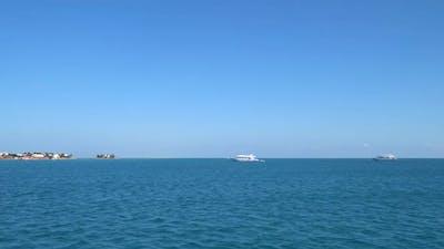 Yachts near a tropical island.