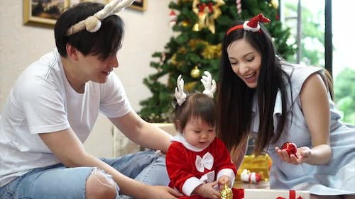 Happy Family with Christmas Tree at Home