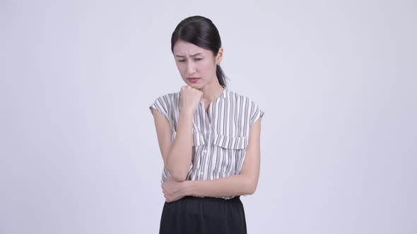 Thumbnail for Serious Asian Businesswoman Thinking and Looking Down