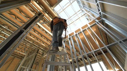 Contractor Worker on a Ladder