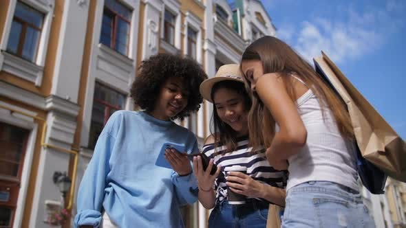 Thumbnail for Multiracial Girls Sharing Smart Phone Outdoors