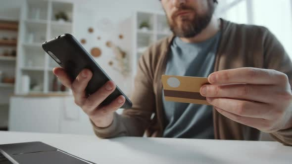 Thumbnail for Close Up Shot of Man Shopping Online via App on Smartphone