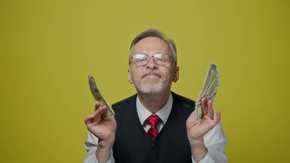 Thumbnail for Portrait of grey haired man with dollars
