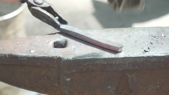 Thumbnail for Blacksmith Forges Metal With A Hammer On The Anvil