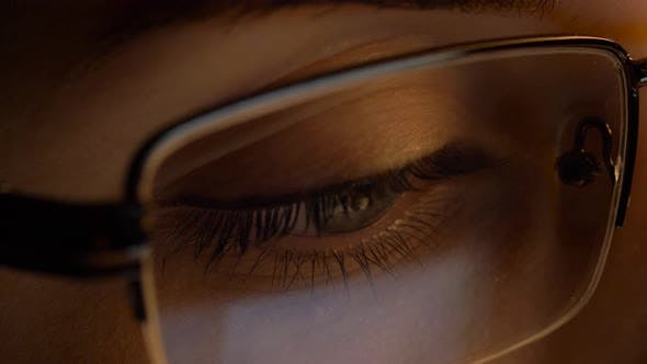 Thumbnail for Close Up of Woman in Glasses Looking at Screen
