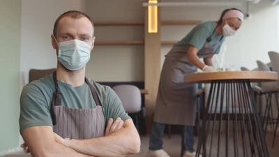 Portrait of Waiter Wearing Medical Mask and Gloves