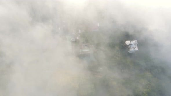 Thumbnail for Morning Fabulous Fog That Covers the Mountains. Aerial Top View of Green Trees Covered with Thick