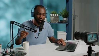 Social Media Influencer Using Podcast Equipment for Music