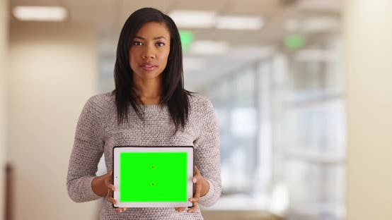 Thumbnail for Businesswoman holding tablet with blank screen for custom content