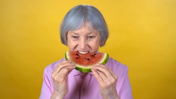 Thumbnail for Elderly Woman Enjoying Watermelon