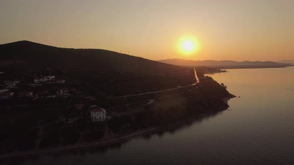 Thumbnail for Aerial View of Trikorfo Beach Coastline at Sunset, Greece