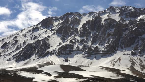 Thumbnail for Rocky Snowy Dome Mountain Summit in Sunny Winter Day