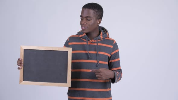 Thumbnail for Young Happy African Man Holding Blackboard and Giving Thumbs Up