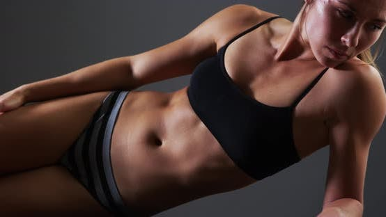 Thumbnail for Healthy fit mixed race woman doing side plank