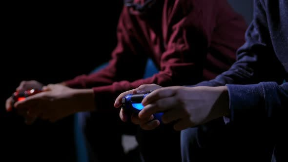 Thumbnail for Closeup Hands of Teen Boys Playing Video Game
