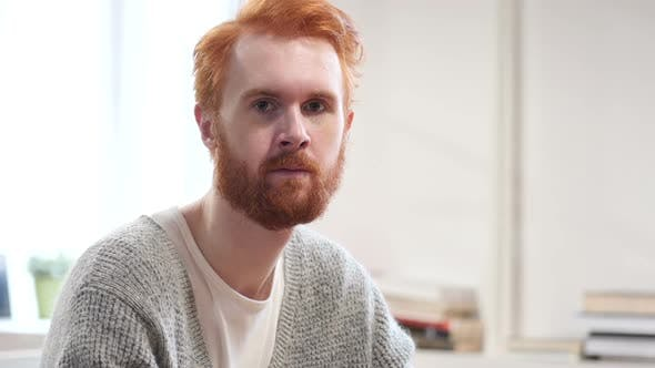 Thumbnail for Portrait of Serious Man with Red Hairs