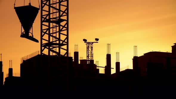 Thumbnail for Silhouette of Crane Working on Construction Site Elevate Concrete Mixer, Sunny Evening, Golden Hour