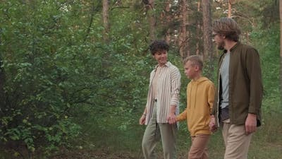 Cheerful Family Walking In Woods