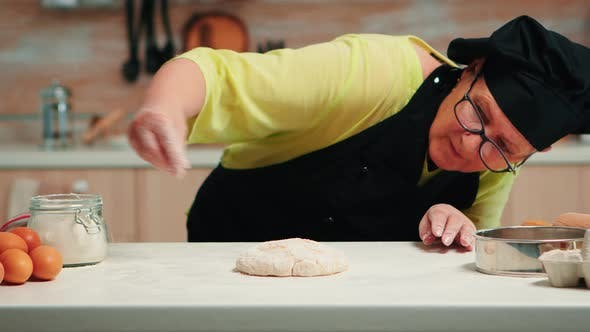 Thumbnail for Woman Is Occupied with Dough Preparation