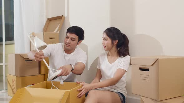 Korean family opening unpacking cardboard boxes and easy and fast service commerce delivery.
