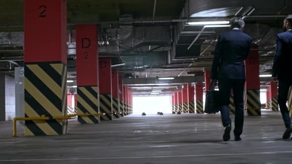 Thumbnail for Businessmen in Suit Walking in Underground Garage