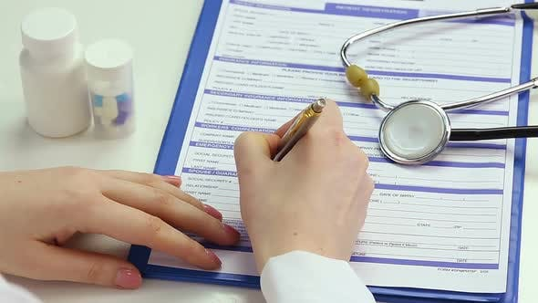 Thumbnail for Female M.D. Filling Out Patient Registration Form, Keeping Clinical Records