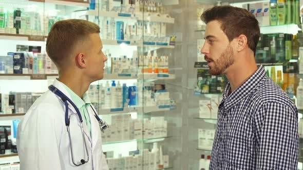 Thumbnail for Doctor Talking To Patient in Drugstore