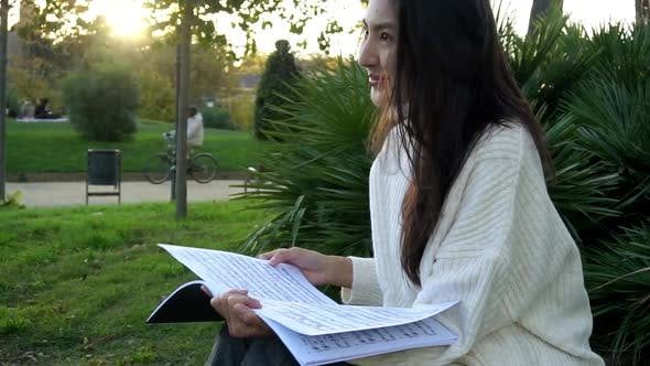 Studying Happy Young Woman Reading Her Book for School. Beautiful Mixed Race Asian Caucasian Girl.