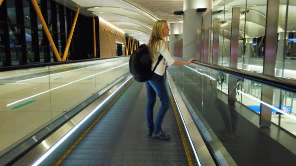 Woman on Escalator at International Airport
